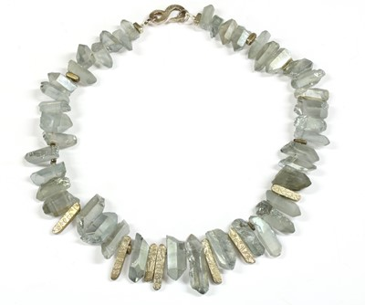 Lot 82 - A contemporary silver and coated quartz crystal necklace