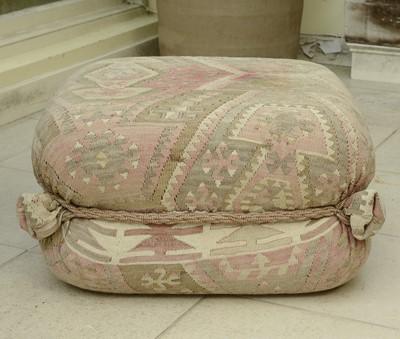 Lot 4 - A kelim-covered pouffe