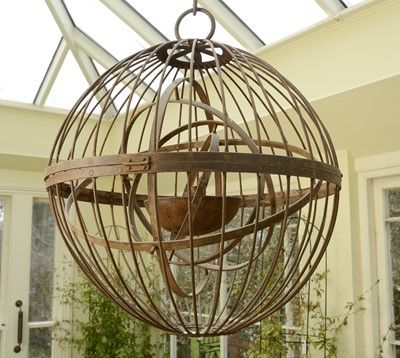 Lot 7 - A large wrought iron gimballed light fitting