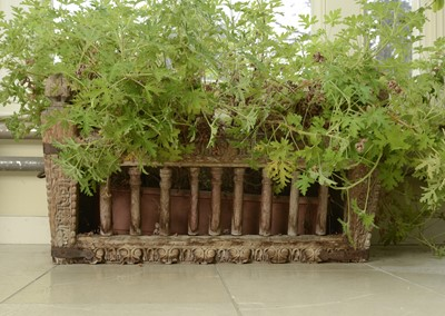 Lot 9 - A carved hardwood manger/plant stand