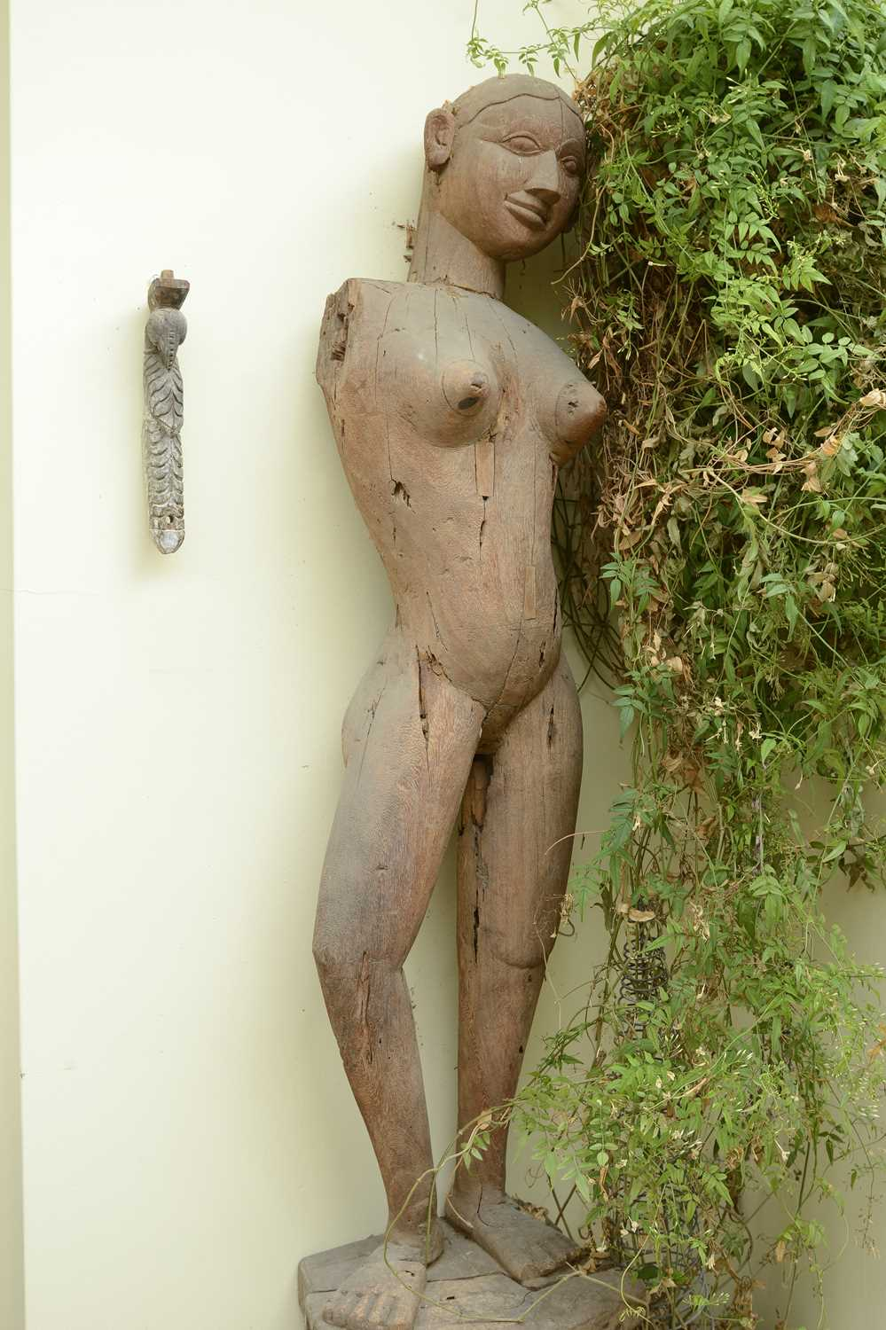 Lot 16 - A near pair of life-sized carved wooden standing female figures