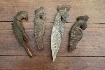 Lot 17 - Four carved wooden figures of birds