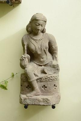 Lot 11 - A carved sandstone figure of a dancer