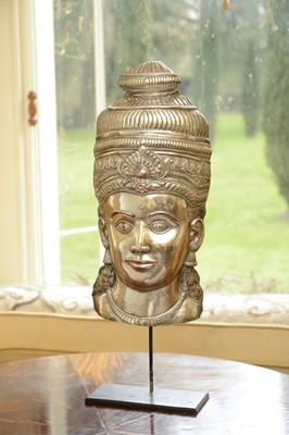 Lot 72 - A white metal relief mask