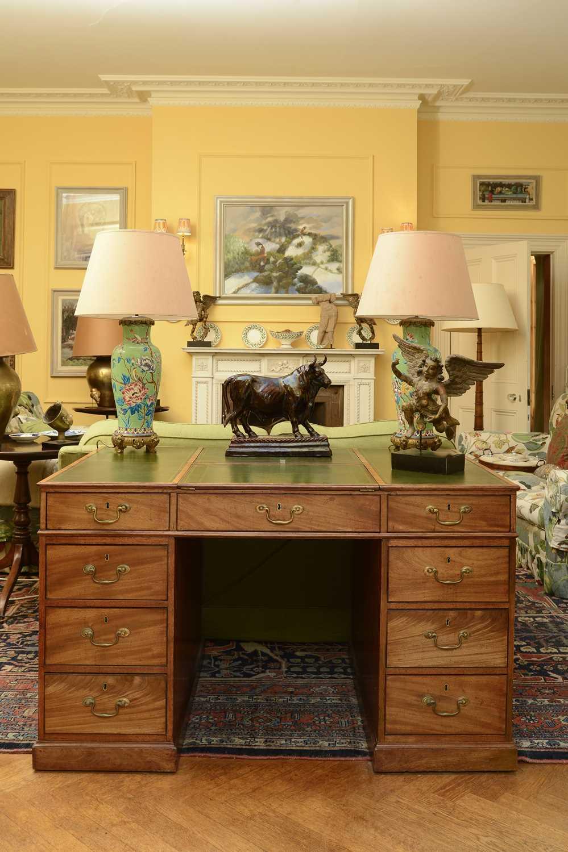 Lot 83 - A strung mahogany twin pedestal partners' desk