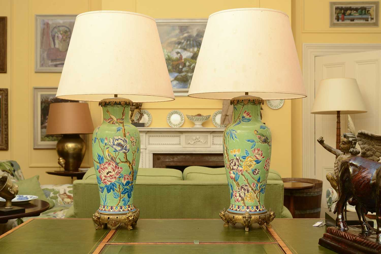 Lot 84 - A pair of chinoiserie-decorated pottery and gilt metal mounted table lamps