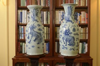 Lot 102 - A near pair of celadon-glazed vases