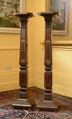 Lot 101 - A pair of mahogany torchères in the manner of George Bullock