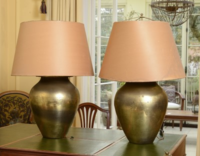 Lot 99 - A pair of large hammered brass table lamps