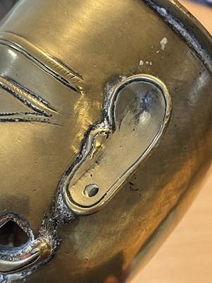 Lot 98 - A brass Nandi head