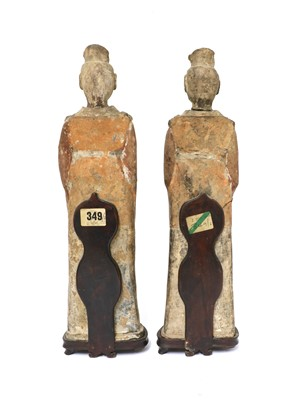 Lot 15 - A pair of Chinese pottery figures