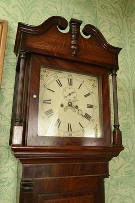 Lot 26 - An oak and mahogany longcase clock