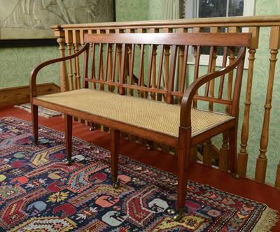 Lot 52 - A Regency-style satinwood settee