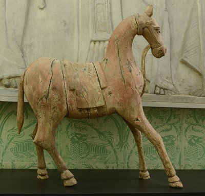 Lot 51 - A carved wooden figure of a horse
