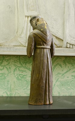 Lot 43 - A carved wooden and painted figure of a monk