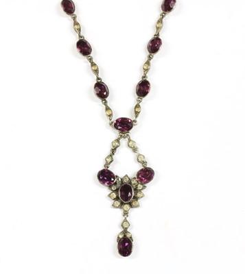 Lot 36 - An Edwardian silver purple and white paste pendant