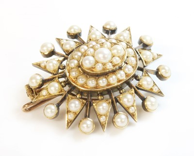 Lot 97 - A Victorian gold split pearl oval starburst brooch/pendant, c.1900