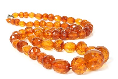Lot 75 - A single row faceted cognac amber bead necklace