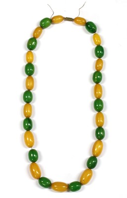 Lot 70 - A single row slightly graduated oval yellow and green Bakelite bead necklace