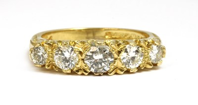 Lot 11-An 18ct gold carved head-style five stone diamond ring