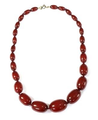 Lot 68 - A single row graduated oval cherry coloured Bakelite bead necklace
