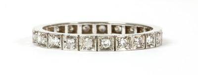 Lot 59 - A white gold diamond full eternity ring