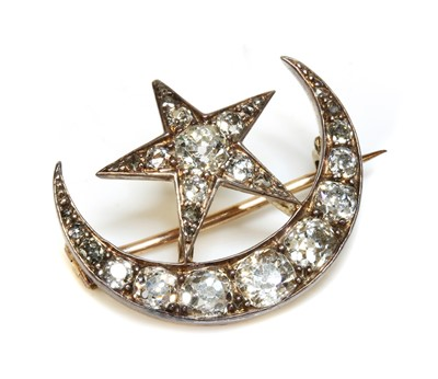 Lot 61 - A late Victorian diamond set crescent and star brooch