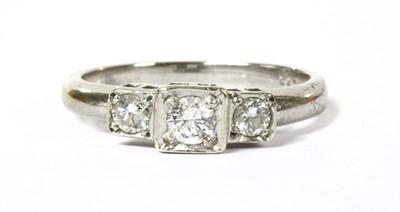 Lot 95 - A 9ct white gold three stone diamond ring