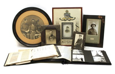 Lot 1-A quantity of framed WWI photographs of soldiers and fretwork search light scene