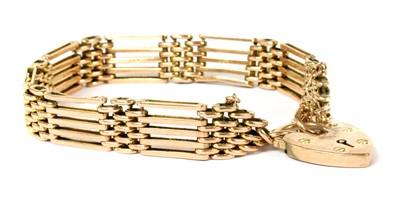 Lot 73 - A gold five row gate bracelet