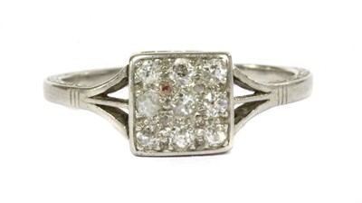 Lot 5-An early 20th century platinum diamond cluster ring