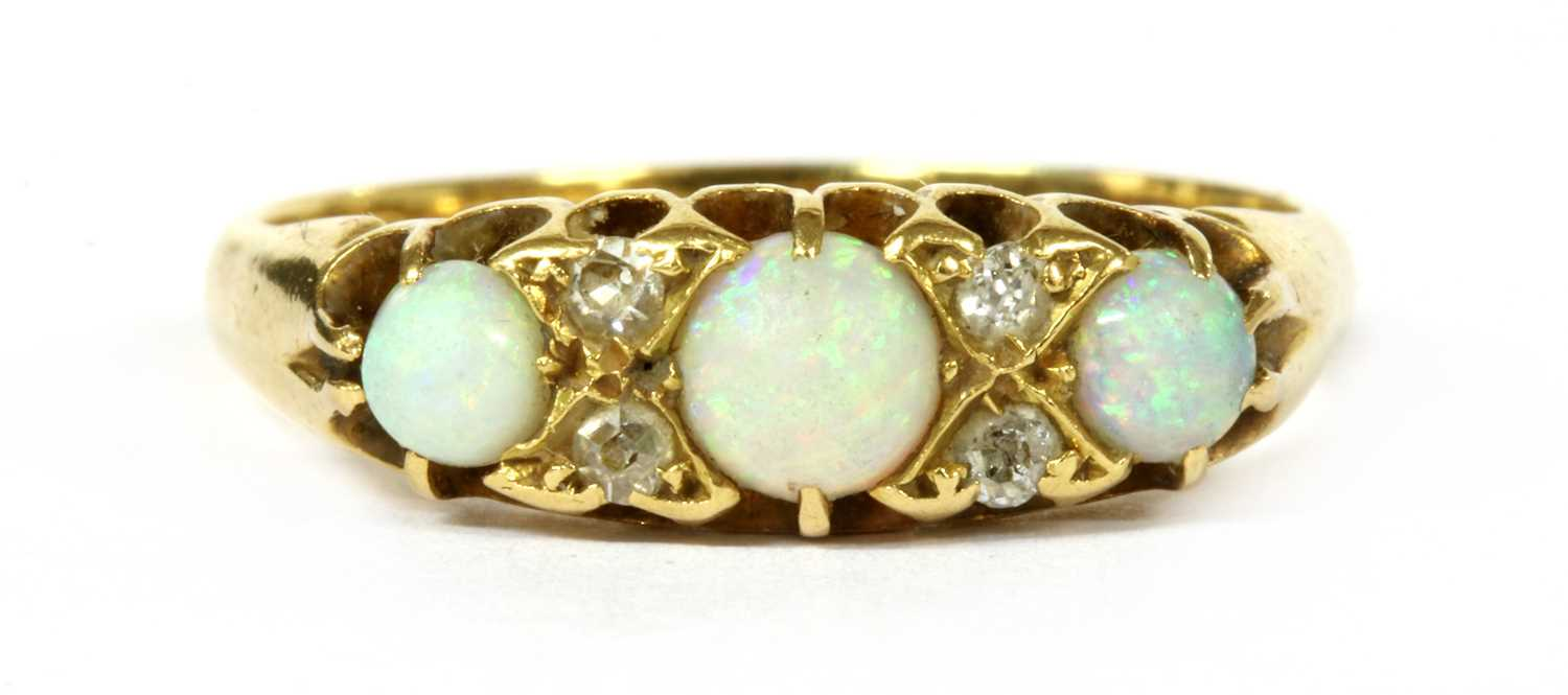 Lot 13 - An Edwardian 18ct gold opal and diamond seven stone ring