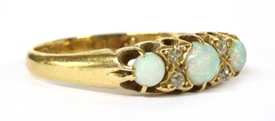 Lot 13-An Edwardian 18ct gold opal and diamond seven stone ring