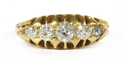 Lot 10-An Edwardian 18ct gold five stone diamond ring