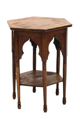 Lot 22 - An Arts and Crafts hexagonal oak lamp table