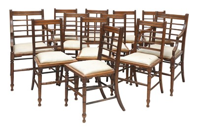 Lot 44 - A set of twelve Arts and Crafts walnut chairs