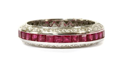Lot 47-A white gold ruby and diamond half eternity ring