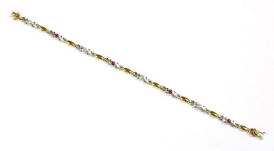 Lot 42-A two colour gold ruby and diamond bracelet