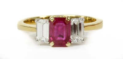 Lot 37-A gold ruby and diamond three stone ring