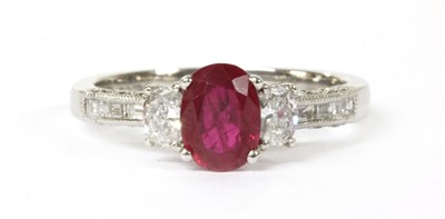 Lot 46-An 18ct white gold ruby and diamond three stone ring