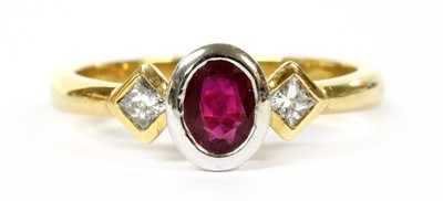 Lot 38-An 18ct gold ruby and diamond three stone ring