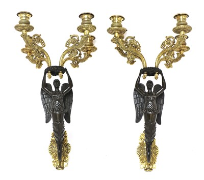 Lot 30 - A pair of French bronze and ormolu wall sconces