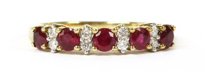 Lot 43-A gold ruby and diamond half eternity ring