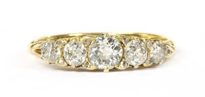 Lot 8 - A gold five stone graduated diamond carved head-style ring