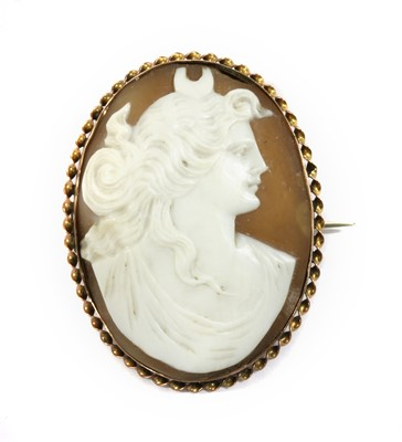 Lot 10 - A gold mounted shell cameo brooch