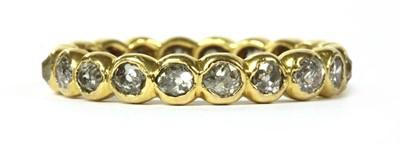 Lot 9 - A gold diamond full eternity ring