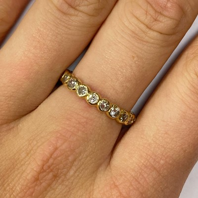 Lot 9-A gold diamond full eternity ring