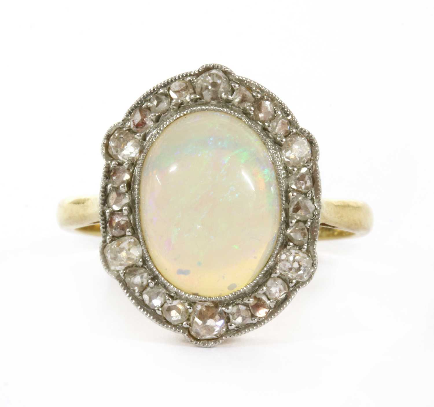 Lot 15 - A gold opal and diamond ring