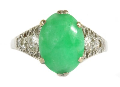 Lot 32 - A white gold jade and diamond ring