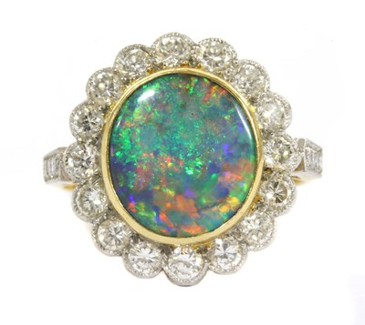 Lot 21 - A gold boulder opal and diamond cluster ring